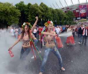 Members of Ukrainian feminist group Femen protests against prostitution near the National Stadium in Warsaw on June 8, 2012, before the opening match of the Euro 2012 football championship between Poland and Greece.  AFP PHOTO / JANEK SKARZYNSKI